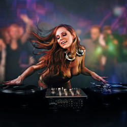 Beautiful DJ girl on decks on the party
